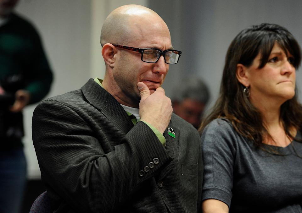 Jeremy Richman, left, weeps as he watches a video of his daughter, Sandy Hook Elementary school shooting victim Avielle Richman, as wife Jennifer Hensel, right, sits beside him during a presentation to the Sandy Hook Advisory Commission in Newtown, Conn., Nov. 14, 2014. (Photo: Jessica Hill/AP)