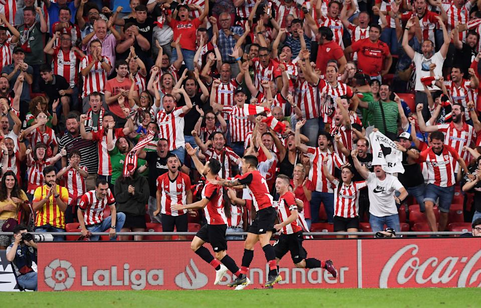 Soccer Football - La Liga Santander - Athletic Bilbao v FC Barcelona - San Mames, Bilbao, Spain - August 16, 2019   Athletic Bilbao's Aritz Aduriz celebrates scoring their first goal with team mates       REUTERS/Vincent West