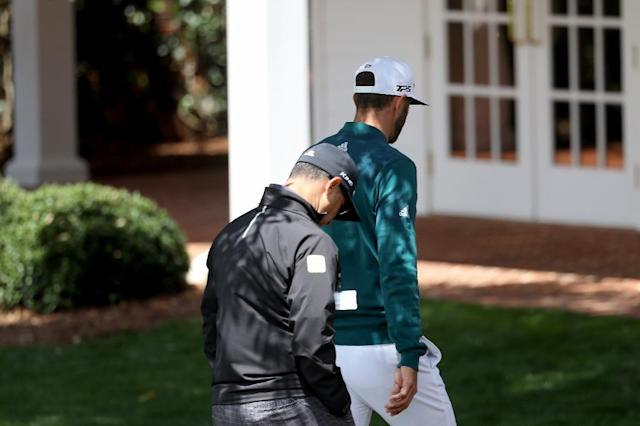 Dustin Johnson of the United States walks to the clubhouse after announcing his withdrawl during the first round of the 2017 Masters Tournament at Augusta National Golf Club on April 6, 2017 in Augusta, Georgia (AFP Photo/Rob Carr)