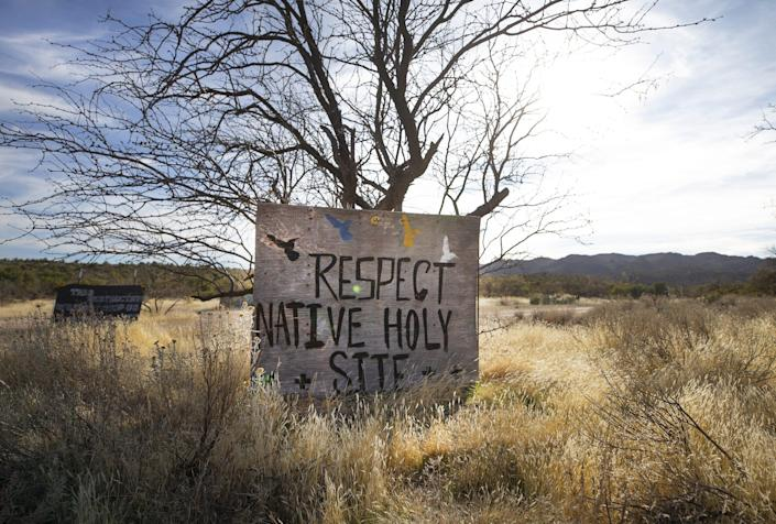 Signs posted at Oak Flat campground protest the possibility of the federal government clearing the way for a copper mine on the land held sacred by the Apache and other Arizona tribes near Oak Flat.