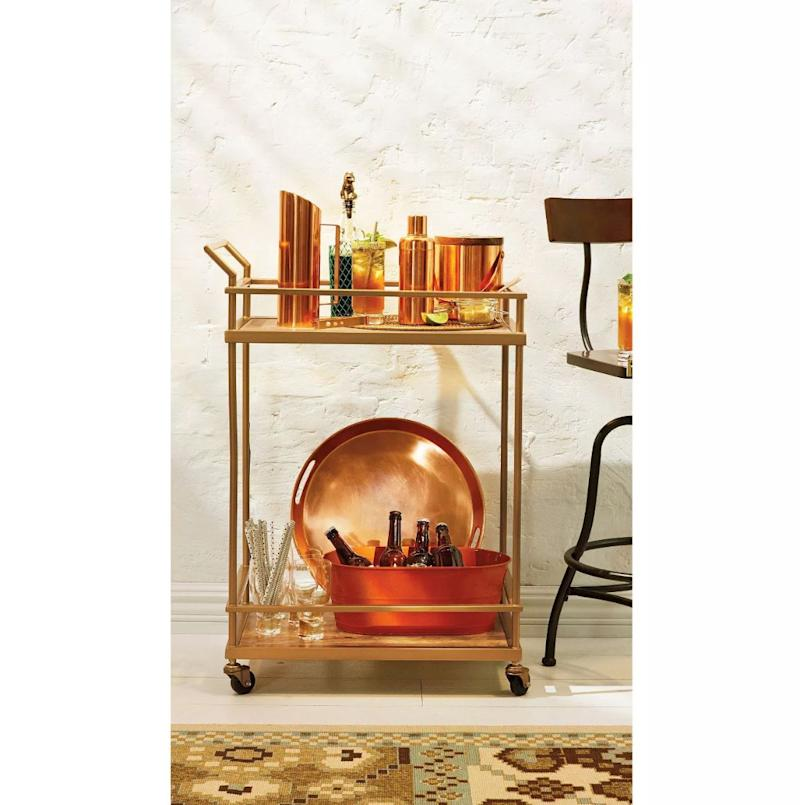 "Get <strong><a href=""https://fave.co/2MJrCv0"" target=""_blank"" rel=""noopener noreferrer"">this wood and glass gold-finished rolling bar cart for 25% off</a></strong>&nbsp;at Target today only. (Photo: Target)"