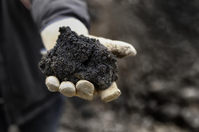 A handful of black oil rich sand from Alberta Canada.(GETTY)