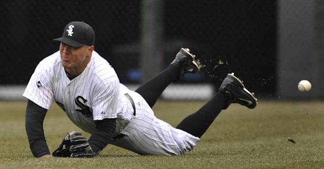 Chicago White Sox right fielder Avisail Garcia misses a 3-RBI double hit by Minnesota Twins' Chris Colabello during the third inning of an baseball game in Chicago, Thursday, April 3, 2014. (AP Photo/Paul Beaty)