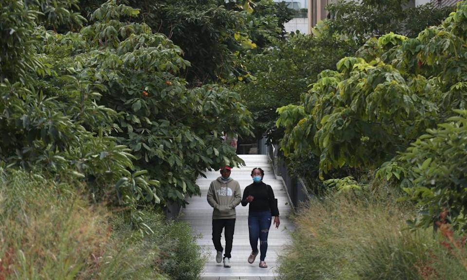two people walk on New York's High Line