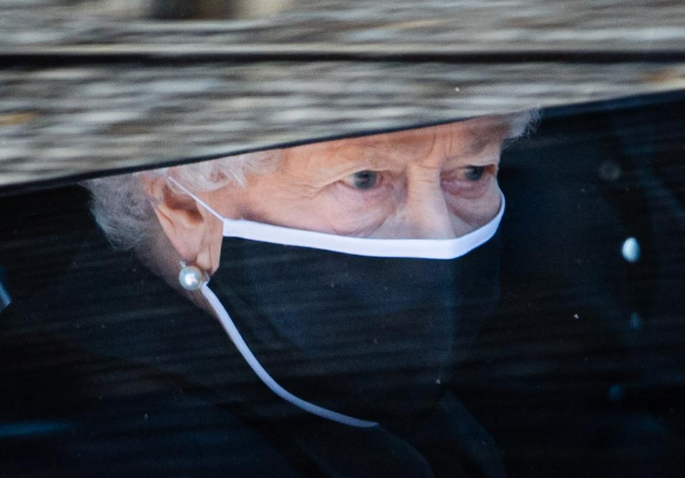 WINDSOR, ENGLAND - APRIL 17: Queen Elizabeth II during the funeral of Prince Philip, Duke of Edinburgh on April 17, 2021 in Windsor, England. Prince Philip of Greece and Denmark was born 10 June 1921, in Greece. He served in the British Royal Navy and fought in WWII. He married the then Princess Elizabeth on 20 November 1947 and was created Duke of Edinburgh, Earl of Merioneth, and Baron Greenwich by King VI. He served as Prince Consort to Queen Elizabeth II until his death on April 9 2021, months short of his 100th birthday. His funeral takes place today at Windsor Castle with only 30 guests invited due to Coronavirus pandemic restrictions. (Photo by Pool/Samir Hussein/WireImage)