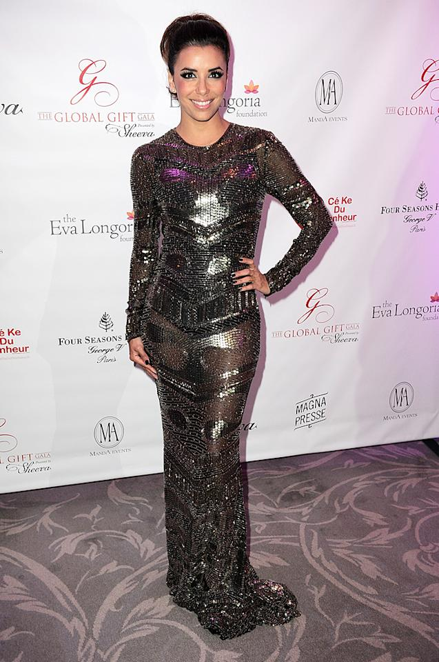 """Also photographed in the South of France was """"Desperate Housewives"""" alumna Eva Longoria, who wore this slinky Reem Acra dress to the annual Global Gift Gala. Diamond studs and a smile made for the perfect accessories. (5/28/2012)"""