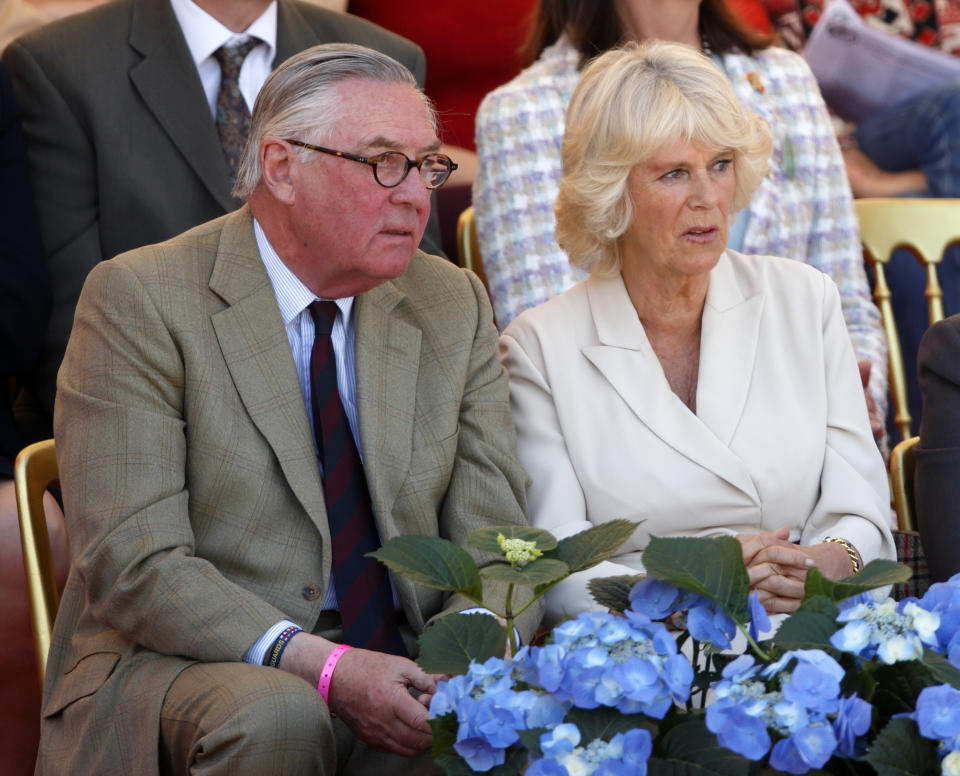 BADMINTON, UNITED KINGDOM - MAY 06: (EMBARGOED FOR PUBLICATION IN UK NEWSPAPERS UNTIL 48 HOURS AFTER CREATE DATE AND TIME) Lord Samuel Vestey and Camilla, Duchess of Cornwall watch the show jumping phase of the Badminton Horse Trials on May 6, 2013 in Badminton, England. (Photo by Max Mumby/Indigo/Getty Images)