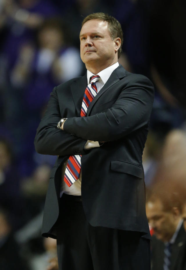 Kansas head coach Bill Self watches his team during the first half of an NCAA college basketball game against Kansas State in Manhattan, Kan., Monday, Feb. 10, 2014. (AP Photo/Orlin Wagner)
