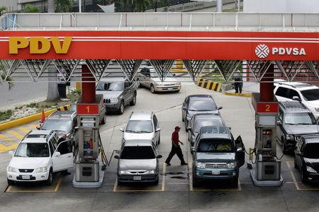 FILE PHOTO: Motorists line up for fuel at a gas station of Venezuelan state-owned oil company PDVSA in Caracas