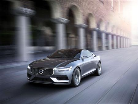 Handout picture of a Volvo Concept Coupe driving past a building.