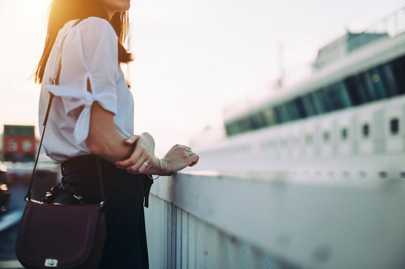 Young woman in cruise terminal waiting to get onboard