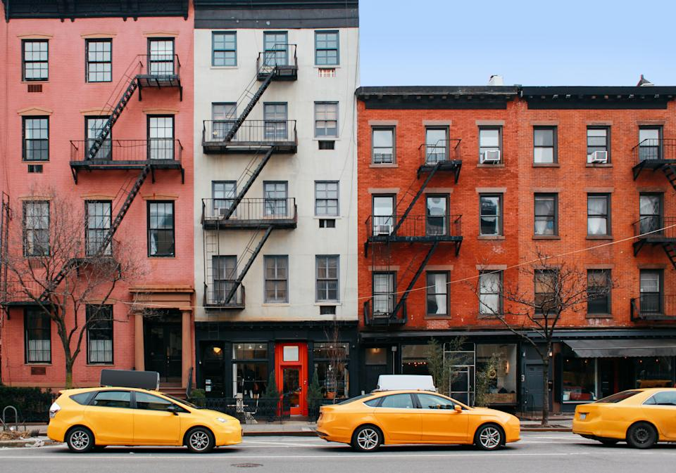 Typical yellow cabs on the streets of New York in winter. Somewhere in Lower Manhattan, near Soho.