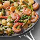 "<p>The gnocchi cooks right in the skillet, along with shrimp, shallots, asparagus and Parmesan cheese, in this gnocchi recipe. Look for shelf-stable gnocchi near other pasta. Serve with baby arugula salad with vinaigrette and a glass of pinot grigio. <a href=""http://www.eatingwell.com/recipe/250492/skillet-gnocchi-with-shrimp-asparagus/"" rel=""nofollow noopener"" target=""_blank"" data-ylk=""slk:View recipe"" class=""link rapid-noclick-resp""> View recipe </a></p>"