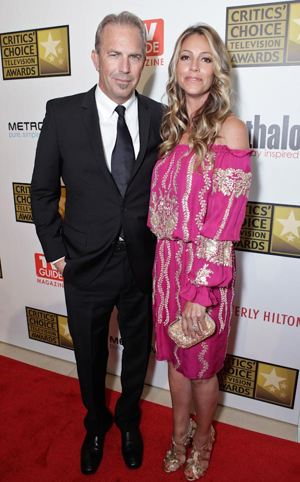Kevin Costner and Christine Baumgartner attend the 2012 Critics' Choice Television Awards at The Beverly Hilton Hotel on June 18, 2012 in Beverly Hills, California.