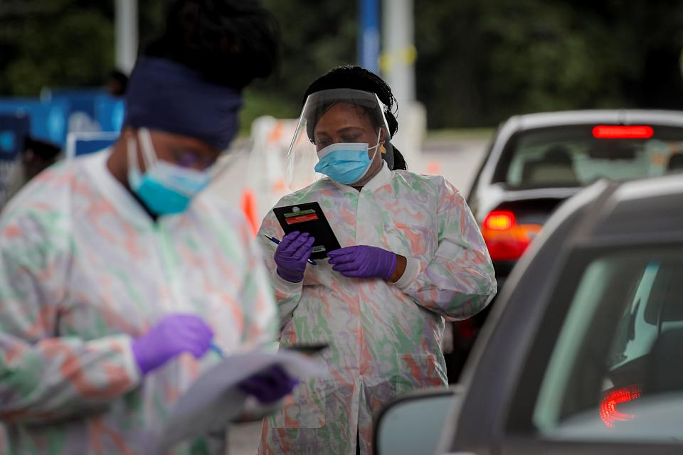 Medical technicians work at a Drive-Thru coronavirus disease (COVID-19) testing facility at the Regeneron Pharmaceuticals company's Westchester campus in Tarrytown, New York, U.S. September 17, 2020. Picture taken September 17, 2020. REUTERS/Brendan McDermid
