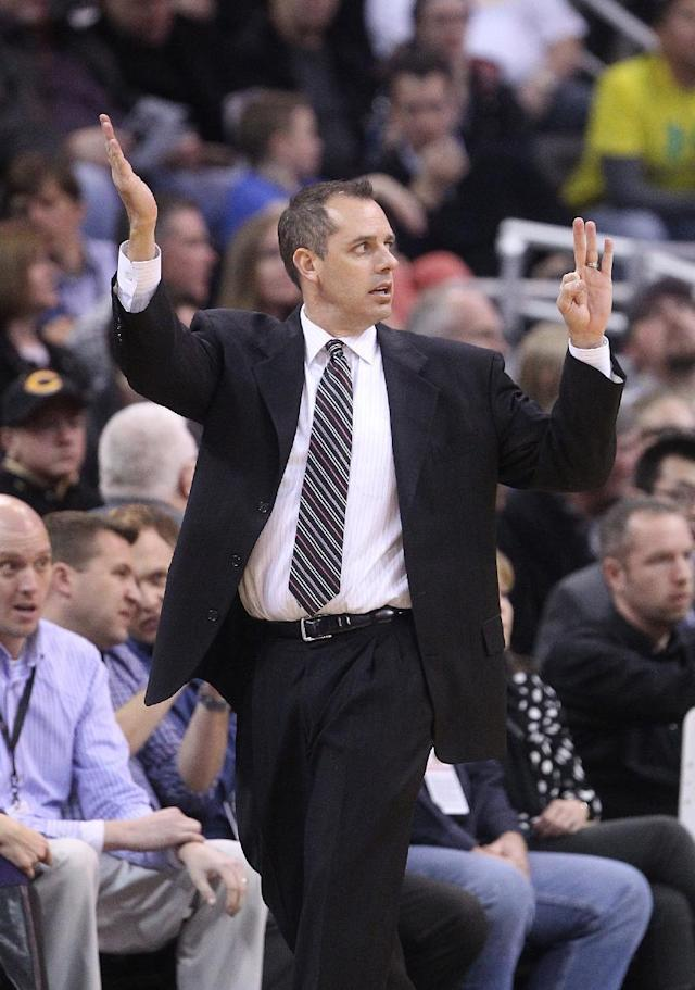 Indiana Pacers coach Frank Vogel calls a play in the first quarter during an NBA basketball game against the Utah Jazz Wednesday, Dec. 4, 2013, in Salt Lake City. (AP Photo/Rick Bowmer)