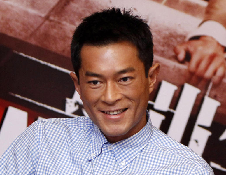 "FILE - In this Sept. 29, 2013 file photo, Hong Kong actor Louis Koo smiles during a press conference to promote his latest film ""Inferno"" in Petaling Jaya, near Kuala Lumpur, Malaysia. The White Storm, a crime thriller starring three of Hong Kong's most prolific actors, opened the Hong Kong Asian Film Festival on Friday, Oct. 25, 2013. Koo, Lau Ching-wan and Nicholas Cheung star in the action film about a clash between an undercover cop and a drug lord that director Benny Chan called his most defining work to date. (AP Photo/Lai Seng Sin, File)"