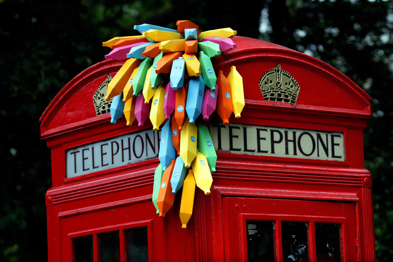 An installation of paper bananas attached to a public telephone box, created by Brazilian graphic artist Breno Pineschi as part of as part of the arts campaign 'Rio Occupation London', is seen in South Kensington, London July 19, 2012. Before London hands over the Olympic baton to Rio De Janeiro, 30 of Rio's top artists have 30 days to blast the capital with their city's most vibrant, cutting edge, culture.  REUTERS/Andre Camara  (BRITAIN - Tags: ENTERTAINMENT SOCIETY SPORT OLYMPICS)