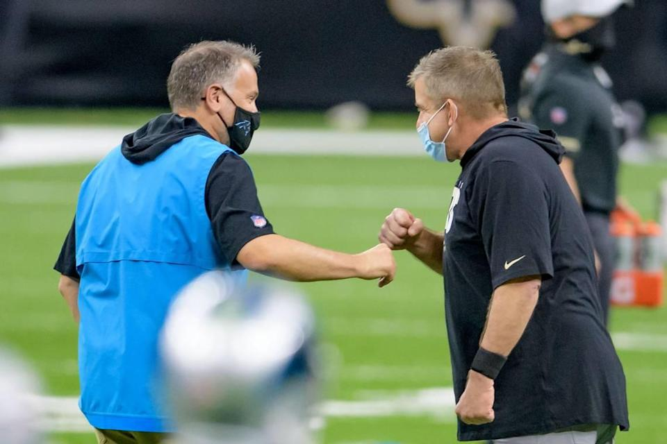 Carolina Panthers head coach Matt Rhule greets New Orleans Saints head coach Sean Payton at the Mercedes-Benz Superdome before a game in October 2020.