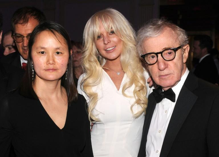 Director Woody Allen is seen with his wife Soon-Yi Previn (L) and actress/singer Lindsay Lohan at a New York fashion gala on February 8, 2012