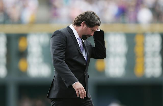 Retired Colorado Rockies first baseman Todd Helton reacts after a ceremony at which his number was retired before the Rockies baseball game with Cincinnati Reds in Denver on Sunday, Aug. 17, 2014. (AP Photo/David Zalubowski)