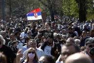 A girl waves with Serbian nation flag during a protest in front of the Serbian Parliament building in Belgrade, Serbia, Saturday, April 10, 2021. Environmental activists are protesting against worsening environmental situation in Serbia. (AP Photo/Darko Vojinovic)