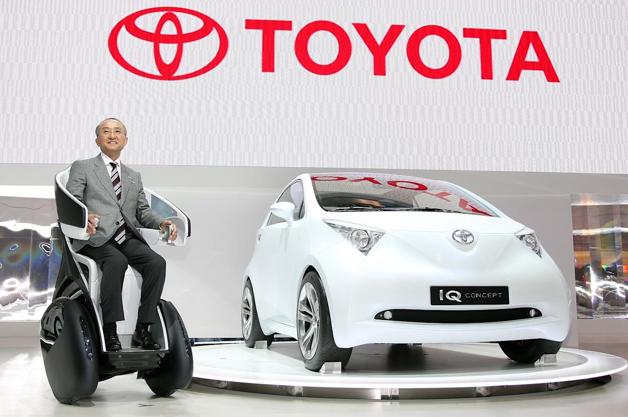 CHIBA, JAPAN - OCTOBER 24:    President of Toyota Motor Corp, Katsuaki Watanabe introduces the company's new vehicle, i-Real and iQ during the press day of the 40th Tokyo Motor Show at Makuhari Messe, on October 24, 2007 in Chiba Prefecture, Japan. The Show, which will be opened to the public from October 27 to November 11 will feature more than 500 vehicles, including 71 world premieres and 97 Japan premieres. The exhibitors are 4 governments, 1 organization and 241 companies from 11 countries and 1region. (Photo by Koichi Kamoshida/Getty Images)