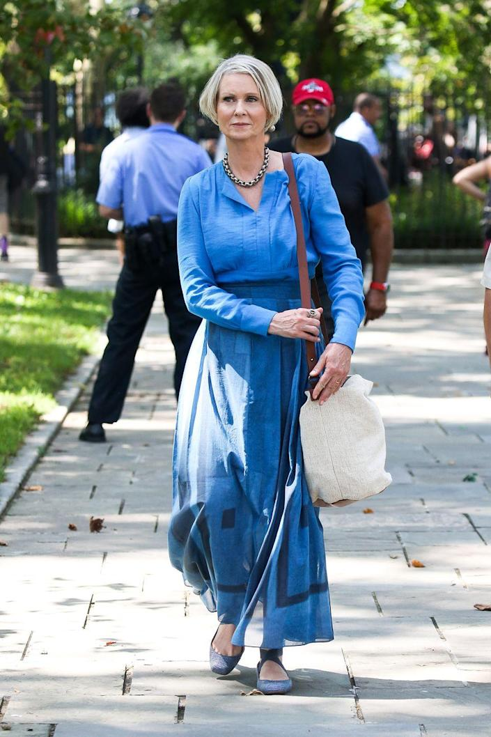 <p>Nixon wore Jessica Simpson's Mandalaye ballet flats in ash blue along with Shinola's Runwell backpack. She also carried an Elk the Label Cardis bag.</p>