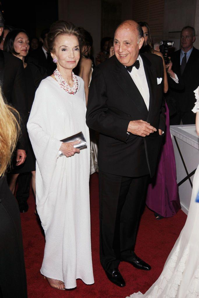 <p>Wearing a flowy white gown while posing with Reinaldo Herrera.</p>