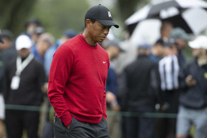 FILE - In this Monday, Sept. 10, 2018, file photo, Tiger Woods walks down a hole during the BMW Championship golf tournament at the Aronimink Golf Club in Newtown Square, Pa. Woods once took for granted that he would end his season at the Tour Championship. Now, just being at East Lake feels like an accomplishment. (AP Photo/Chris Szagola, File)