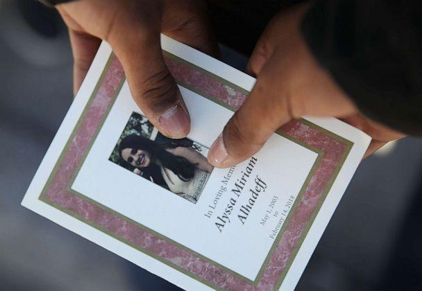 PHOTO: A person holds a program from the funeral of Alyssa Alhadeff at the Garden of Aaron at Star of David Memorial Gardens, Feb. 16, 2018, in Parkland, Fla.  (Joe Raedle/Getty Images, FILE)