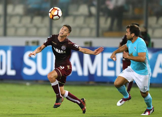 Soccer Football - Peru's Sporting Cristal v Argentina's Lanus - Copa Sudamericana - Nacional Stadium, Lima, Peru - March 7, 2018. Tomas Belmonte of Lanus and Renzo Revoredo of Sporting Cristal in action. REUTERS/Mariana Bazo