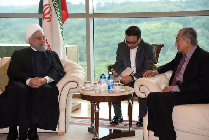 Malaysia's Prime Minister Mahathir Mohamad meets with Iranian President Hassan Rouhani at Prime Minister Office in Putrajaya