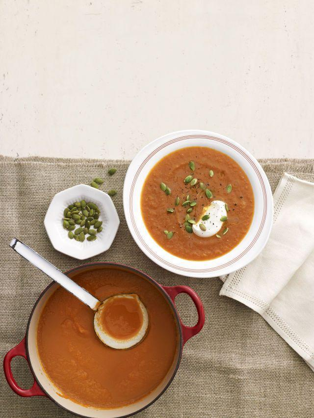 """<p>This simple spiced carrot soup gets added crunch from toasted pumpkin seeds and a mellow flavor from a drizzle of creamy yogurt.</p><p><strong><a href=""""https://www.countryliving.com/food-drinks/recipes/a4321/moroccan-carrot-soup-recipe-clx1113/"""" rel=""""nofollow noopener"""" target=""""_blank"""" data-ylk=""""slk:Get the recipe"""" class=""""link rapid-noclick-resp"""">Get the recipe</a>.</strong></p>"""