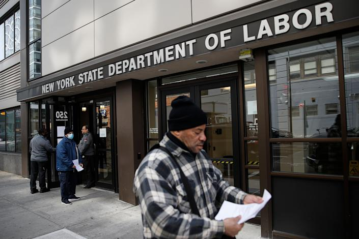 Visitors to the Department of Labor March 18 are turned away at the door by personnel due to closures over coronavirus concerns in New York. A record-high number of people applied for unemployment benefits as layoffs engulfed the United States. (Photo: ASSOCIATED PRESS)