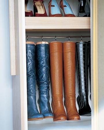 """<div class=""""caption-credit""""> Photo by: Martha Stewart Living</div><b>Boot Hangers</b> <br> Homemade hangers preserve the shape of tall boots and maximize space. They're created by replacing the knobs on cedar boot trees with large cup hooks, which are screwed into the tops. The trees and boots then hang from a cafe-curtain rod. <br> <b>Related:</b> <br> <b><a href=""""http://www.marthastewart.com/275539/bedroom-decorating-ideas/@center/277006/bedroom-and-bathroom-decorating?xsc=synd_yshine"""" rel=""""nofollow noopener"""" target=""""_blank"""" data-ylk=""""slk:23 Ways to Decorate Your Bedroom"""" class=""""link rapid-noclick-resp"""">23 Ways to Decorate Your Bedroom</a> <br> <a href=""""http://www.marthastewart.com/275280/bathroom-organization-tips/@center/277006/bedroom-and-bathroom-decorating?xsc=synd_yshine"""" rel=""""nofollow noopener"""" target=""""_blank"""" data-ylk=""""slk:24 Ways to Organize Your Bathroom"""" class=""""link rapid-noclick-resp"""">24 Ways to Organize Your Bathroom</a></b> <br>"""
