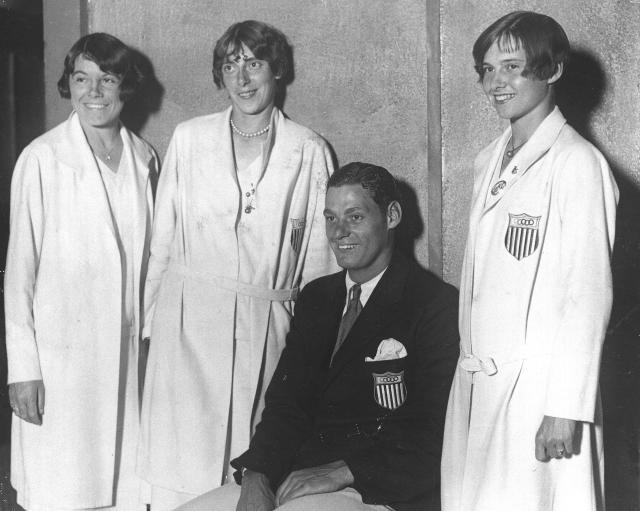 Members of the U.S. Olympic team appear happy to be home as they arrive at the McAlpin Hotel for a reception in New York, Aug. 22, 1928. From left to right: Katharine Maguire of St. Louis; Dolores Boeck of St. Louis; Johnny Weissmuller, champion swimmer from Chicago; Elizabeth Robinson, 17-year-old sprint champion from Chicago. (AP Photo)