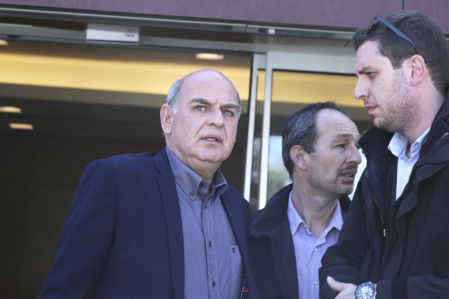 President of the Hellenic Football Federation Vagelis Grammenos , left, looks on at at the Hellenic Football Federation premises in Athens, on Wednesday, March 14, 2018. FIFA has sent a delegation to Greece to discuss the country's soccer crisis, after the government indefinitely suspended top league matches. The suspension followed a pitch invasion by the gun-toting owner of PAOK Thessaloniki Sunday after a late goal for his team was disallowed by the referee. (AP Photo/Petros Giannakouris)