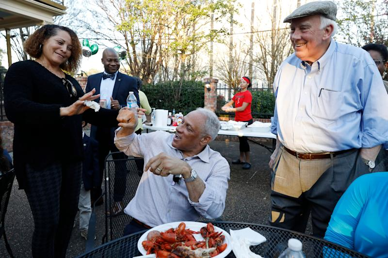 Mike Espy (center), the Democratic nominee for a Senate seat in Mississippi, attempts to fist bump at a crawfish boil in Jackson on March 10, 2020. Espy faces incumbent GOP Sen. Cindy Hyde-Smith in November. (Photo: Rogelio V. Solis/ASSOCIATED PRESS)
