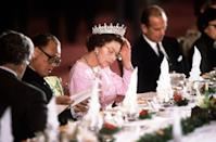 """<p>The Queen paired a feminine pink dress with a tiara <a href=""""https://www.townandcountrymag.com/style/jewelry-and-watches/g37004369/queen-mary-iconic-tiaras-photos/"""" rel=""""nofollow noopener"""" target=""""_blank"""" data-ylk=""""slk:from Queen Mary's collection"""" class=""""link rapid-noclick-resp"""">from Queen Mary's collection</a> for a banquet in China in 1986.</p><p><strong>More:</strong> <a href=""""https://www.townandcountrymag.com/style/jewelry-and-watches/g14504829/queen-elizabeth-jewels-crowns-tiaras/"""" rel=""""nofollow noopener"""" target=""""_blank"""" data-ylk=""""slk:The Queen's Most Extravagant Tiaras"""" class=""""link rapid-noclick-resp"""">The Queen's Most Extravagant Tiaras</a></p>"""