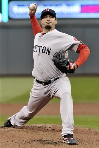 Boston Red Sox pitcher Josh Beckett throws against the Minnesota Twins in the first inning of a baseball game, Tuesday, April 24, 2012, in Minneapolis. (AP Photo/Jim Mone)