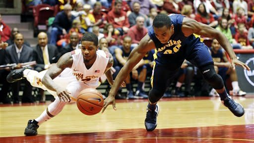 Iowa State guard Korie Lucious, left, fights for a loose ball with North Carolina A&T guard Lamont Middleton during the first half of an NCAA college basketball game, Tuesday, Nov. 20, 2012, in Ames, Iowa. (AP Photo/Charlie Neibergall)