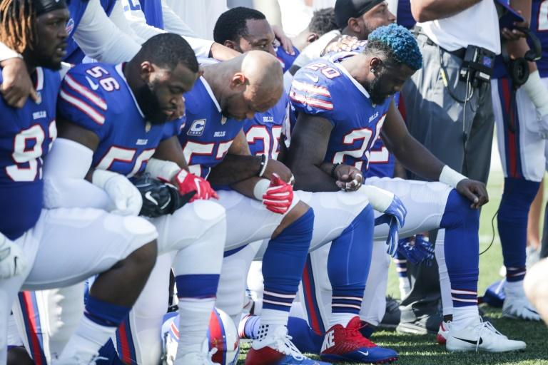 Buffalo Bills players kneel during the American national anthem before their NFL game against the Denver Broncos, at New Era Field in Orchard Park, New York, in September 2017