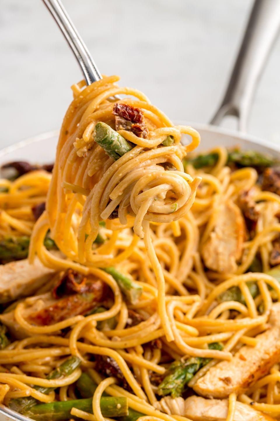 """<p>Asparagus lovers, prepare to freak out over this sundried tomato creamy pasta.</p><p>Get the recipe from <a href=""""/cooking/recipe-ideas/recipes/a46534/asparagus-sundried-tomato-and-chicken-spaghetti-recipe/"""" data-ylk=""""slk:Delish"""" class=""""link rapid-noclick-resp"""">Delish</a>.</p>"""