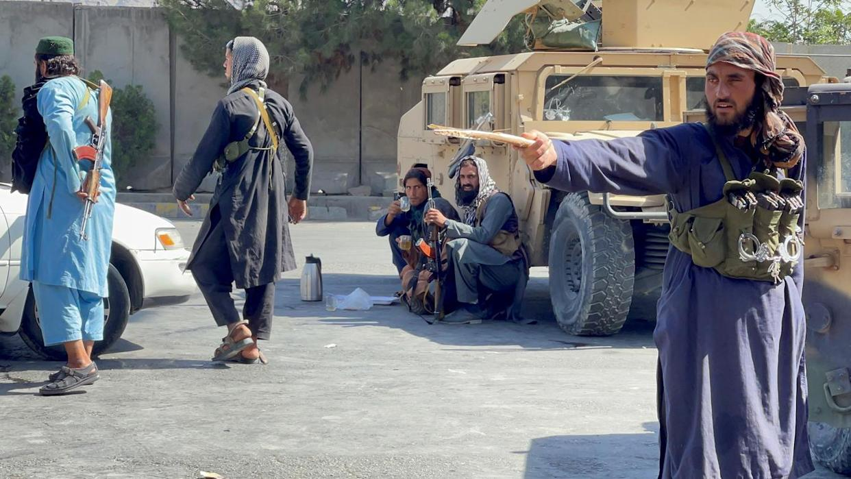 Taliban forces block the roads around the airport in Kabul on Aug. 27, 2021.