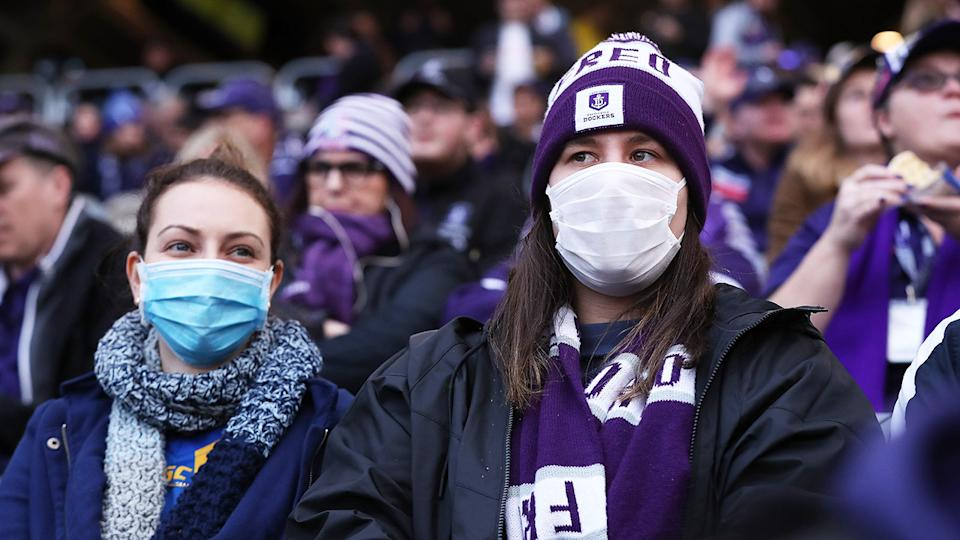 Spectators, pictured here wearing face masks during West Coast's win over Fremantle.