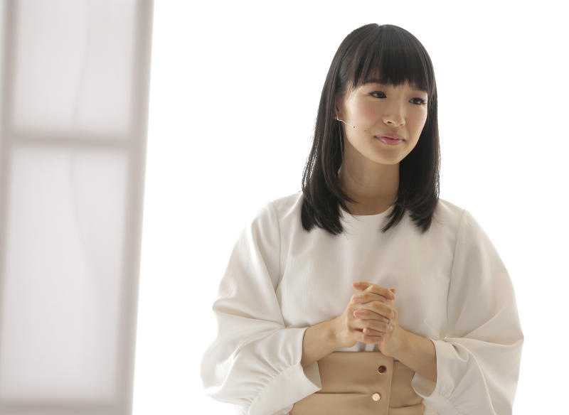 FILE- In this July 11, 2018, file photo, Japanese organizational expert Marie Kondo appears at a media event to introduce her new line of storage boxes in New York. Kondo is sparking joy among shoppers feeling the urge to clean out their homes. But once you master the Japanese organizing expert's novel approach to de-cluttering, what do you do with all the stuff you don't want? (AP Photo/Seth Wenig, File)