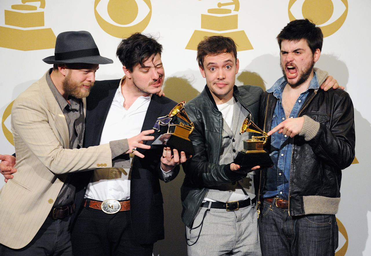 "Ted Dwayne, Marcus Mumford, Ben Lovett and ""Country"" Winston Marshall of Mumford and Sons pose in the press room during the 55th Annual GRAMMY Awards at STAPLES Center on February 10, 2013 in Los Angeles, California.  (Photo by Steve Granitz/WireImage)"