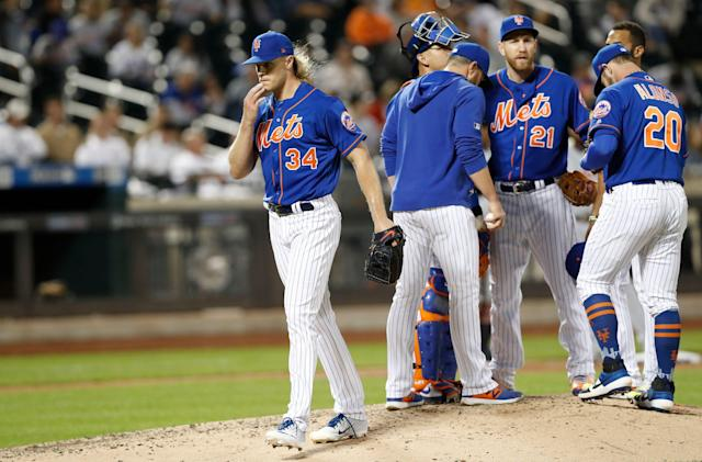 """<a class=""""link rapid-noclick-resp"""" href=""""/mlb/teams/ny-mets/"""" data-ylk=""""slk:New York Mets"""">New York Mets</a> starting pitcher <a class=""""link rapid-noclick-resp"""" href=""""/mlb/players/9597/"""" data-ylk=""""slk:Noah Syndergaard"""">Noah Syndergaard</a> (34) leaves the mound after manager Mickey Callaway, second from left, replaced him during the sixth inning of a baseball game against the Detroit Tigers, Friday, May 24, 2019, in New York. Mets third baseman Todd Frazier (21) and catcher Wilson Ramos (40) also stand on the mound. (AP Photo/Kathy Willens)"""