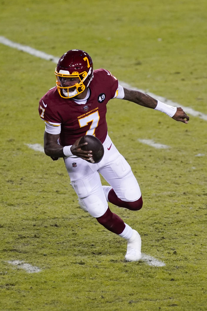 Washington Football Team quarterback Dwayne Haskins (7) runs with the ball during the first half of an NFL football game against the Carolina Panthers, Sunday, Dec. 27, 2020, in Landover, Md. (AP Photo/Mark Tenally)